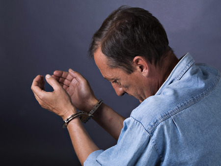 swindler: Man mature with handcuffs Stock Photo