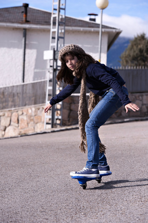 Girl playing with a wave board. Skateboard Stok Fotoğraf