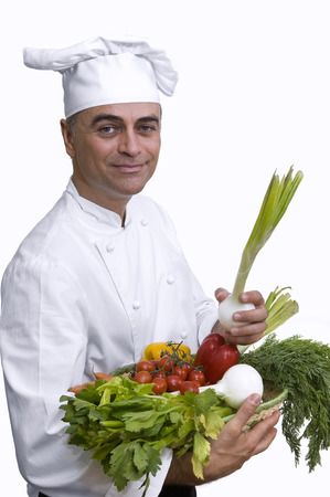 Chef holding a basket with vegetables