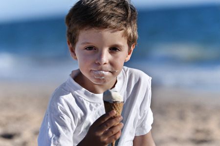 Portrait of a boy on the beach, eating ice cream Stok Fotoğraf