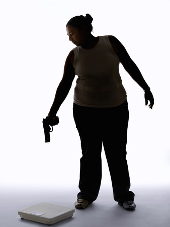 Young woman shooting at a scale