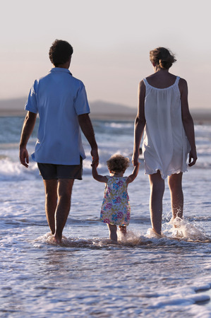 Family walking on the beach Stok Fotoğraf - 38161165