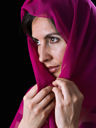 Woman with the head covered, on black background Stok Fotoğraf - 38614842