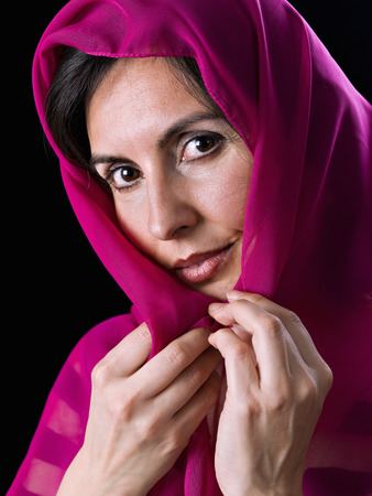turkish ethnicity: Woman with the head covered, on black background