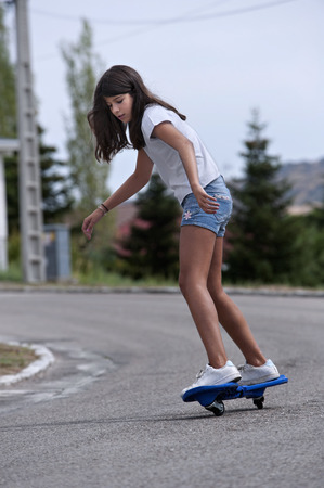 Girl playing with a wave board. Skateboard Stok Fotoğraf - 38162043