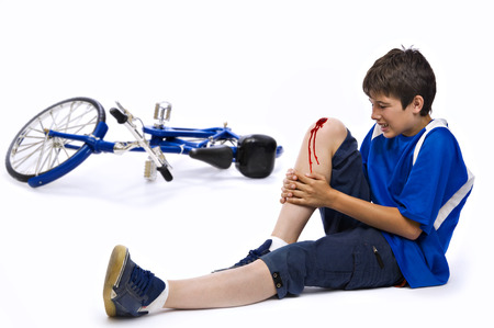 accident: Young man who has had an accident in bicycle