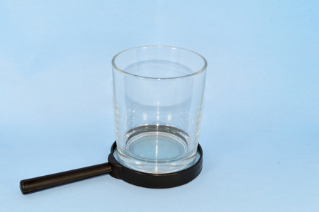 pursue: Empty Glass over the magnifying glass search for meaning water