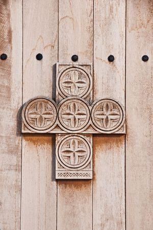 floor coverings: Wooden cross Stock Photo