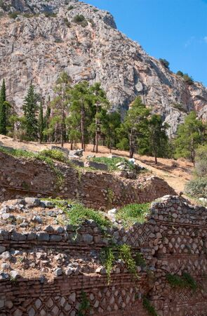 Ruins of the ancient greek wall patterns at Delphi, Greece photo