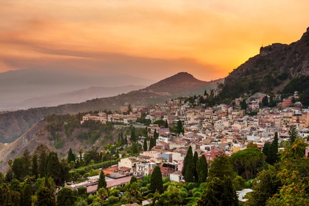 Taormina city and Etna volcano during dramatic sunset, Sicily island, Italy