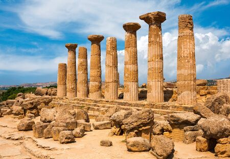 valley of the temples: Ercole temple with dramatic sky in the Valley of the Temples, Agrigento, Sicily island, Italy Stock Photo