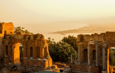 Ancient greek amphitheatre in Taormina city during sunset, Sicily island, Italy