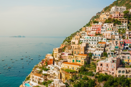 View of the Positano city at sunrise on Amalfi Coast, Italy