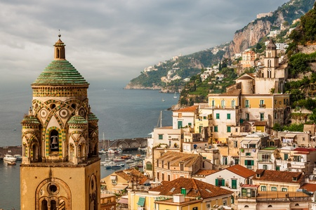 Aerial view of tthe Amalfi city with bell tower of the Cathedral in front, Italy