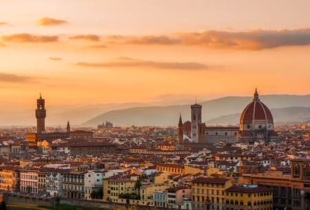 florence: Golden sunset over Palazzo Vecchio and Cathedral of Santa Maria del Fiore (Duomo), Florence, Italy