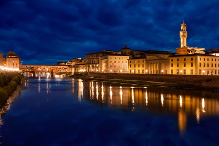 palazzo: Ponte Vecchio and Palazzo Vecchio after sunset with reflections on Arno river, Florence, Italy