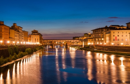 Ponte Vecchio at dusk with reflections on Arno river, Florence, Italy