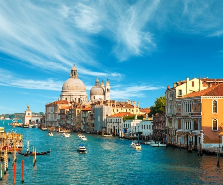 Beautiful view of the Grand Canal and Basilica Santa Maria della Salute in the late evening with very interesting clouds, Venice, Italy Standard-Bild