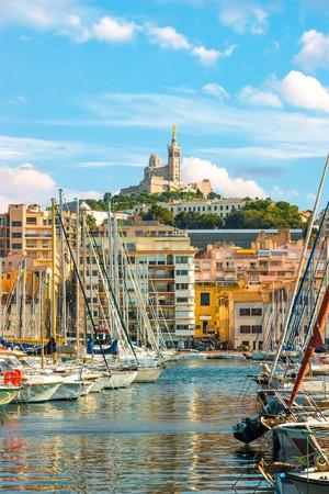 The old Vieux port of Marseille with Notre Dame de la Garde at back