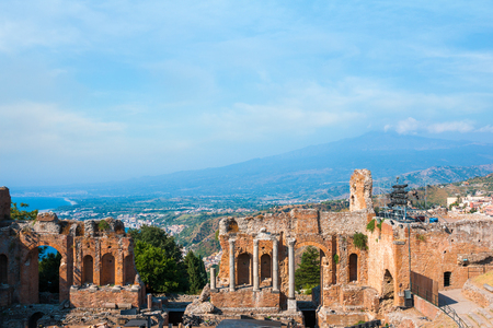 taormina: Ancient greek amphitheatre in Taormina city and mountain Etna in the back, Sicily island, Italy Stock Photo