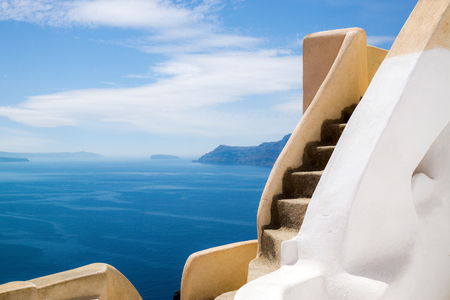 Brown stairs of the traditional greek apartment with a great view on sea, Santorini island, Greece