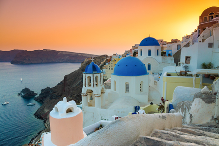Colorful sunset over the churches of Oia village, Santorini island, Greece Stock Photo