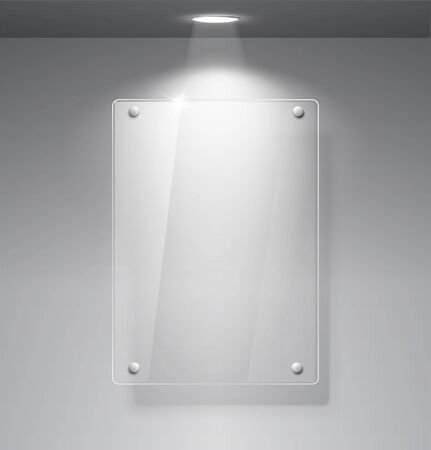 Realistic empty glass frame on a wall with lights for images and advertisement