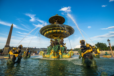 madeleine: Fountain of River Commerce and Navigation at the Place de la Concorde with beautiful clouds, Paris, France