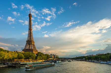 seine: Beautiful sunset over Eiffel Tower and Seine river with puffy clouds, Paris, France