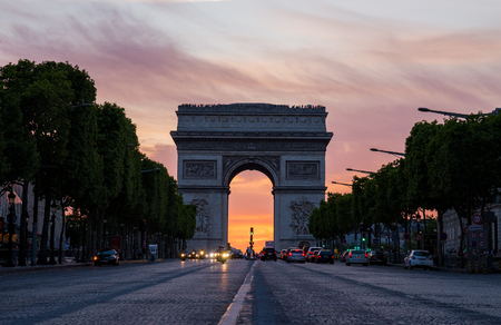 champs elysees quarter: Arch of Triumph (Arc de Triomphe) with dramatic sunset behind, Paris, France Stock Photo
