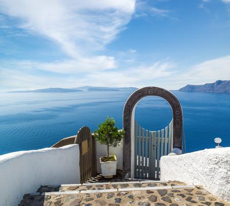 Fantástica vista desde la isla de Santorini, Pueblo de Oia Foto de archivo - 32095988