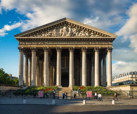 Madeleine church (L'église de la Madeleine) under dramatic sky, Paris, France