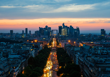 View of the business district of the Paris Le Defence form the Arch of Triumph at sunset, France Stock Photo