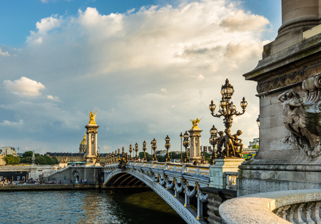 alexander: Alexandre III bridge (Pont Alexandre III) and the National Residence of the Invalids (Les Invalides) during dramatic sunset, Paris, France Stock Photo