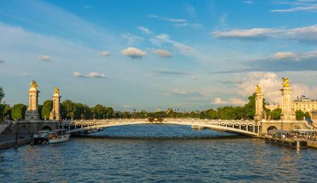 Alexandre III bridge (Pont Alexandre III) during dramatic sunset, Paris, France