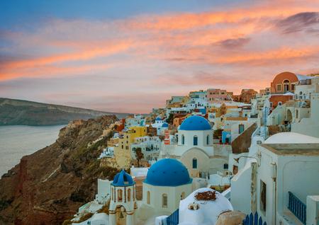 Churches of Oia village during beautiful sunset, Santorini island, Greece