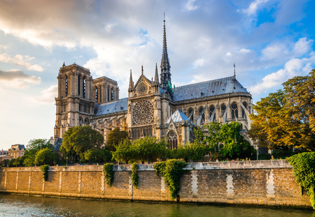 Gorgeous sunset over Notre Dame cathedral with puffy clouds, Paris, France Reklamní fotografie - 35327778