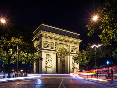 Arch of Triumph (Arc de Triomphe) at night with light trails, Paris, France