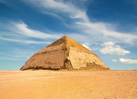 Famous Bent Pyramid under puffy clouds, Dahshur, Egypt