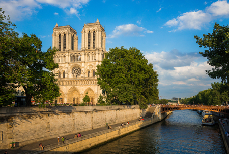 notre dame cathedral: Notre Dame cathedral at late evening with beautiful clouds, Paris, France Stock Photo