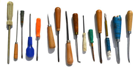 many different, old screwdriver on white background photo