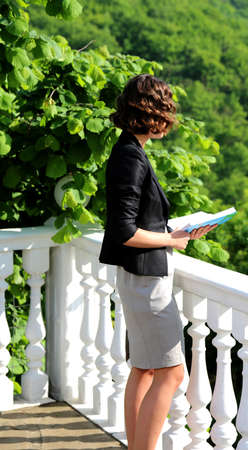 woman reading a poem on the balcony of the palace Stock Photo