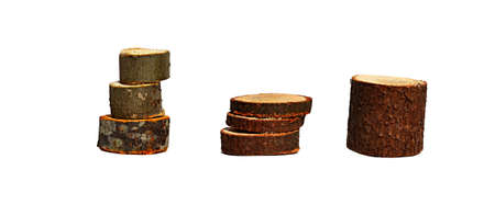 three stacks of round slices of trees on a white background