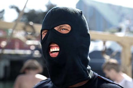 a masked gunman going on a robbery in the park attractions