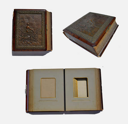 leather, old book with the engraving on the cover isolated on white background