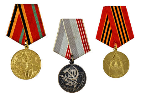 three military medals isolated on white background