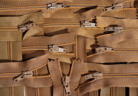 background texture from a variety of clothing zippers