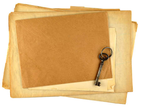 stack of old papers and old key isolated on white