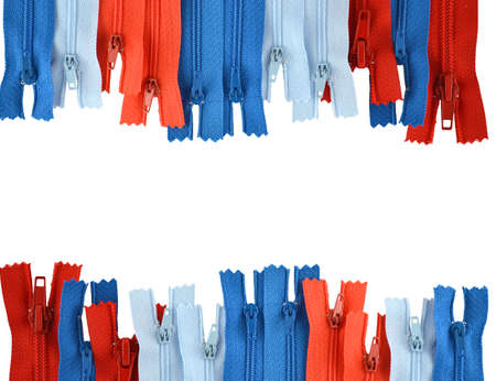 background consisting of colored zippers for clothes, isolated on white Stock Photo
