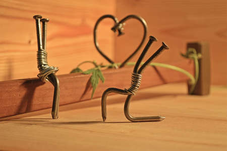 reconciliation: miniature of nails and a hammer symbolizing love Stock Photo